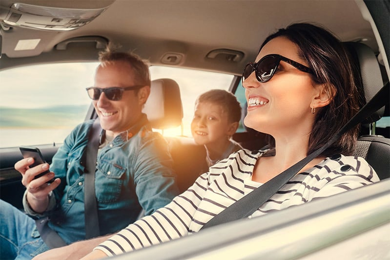 luxury travel agents offering car hire, family in car shot