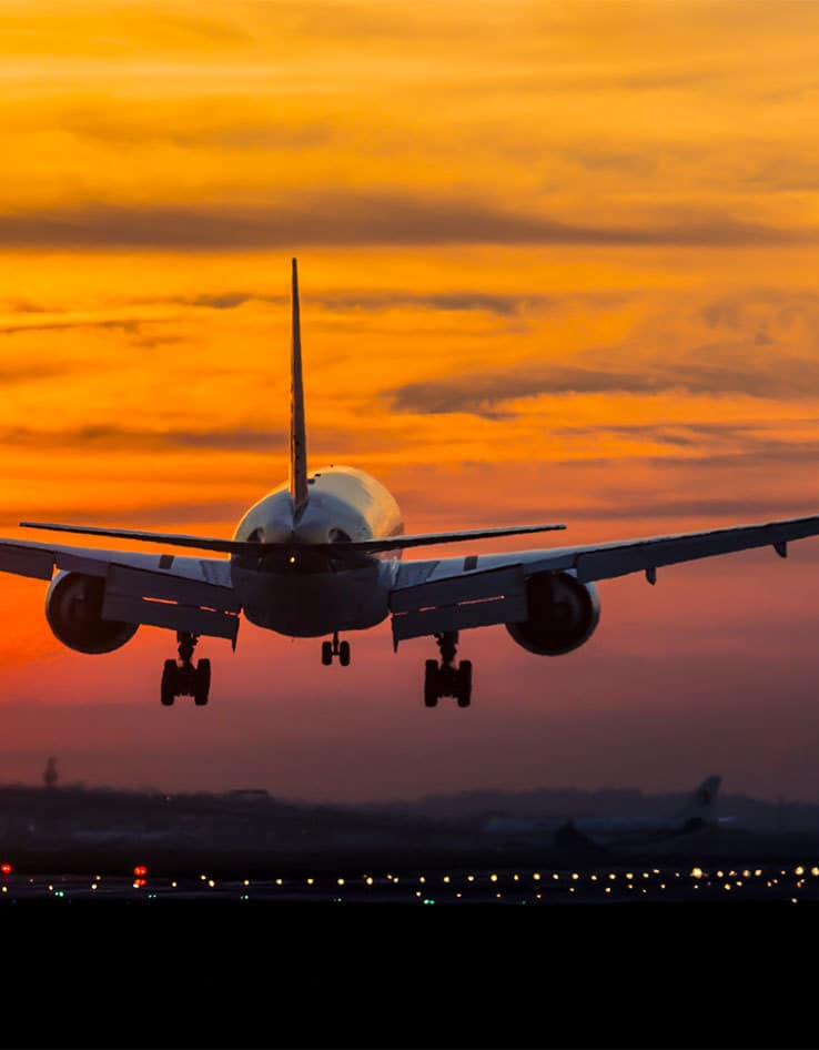 luxury travel agents, plane taking off at sunset