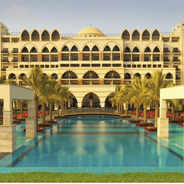View of the resort across the swimming pool at Jumeirah Zabeel Saray, Dubai in UAE