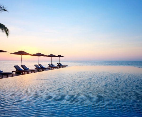 View of the infinity pool to the sea at LUX South Ari Atoll in Maldives