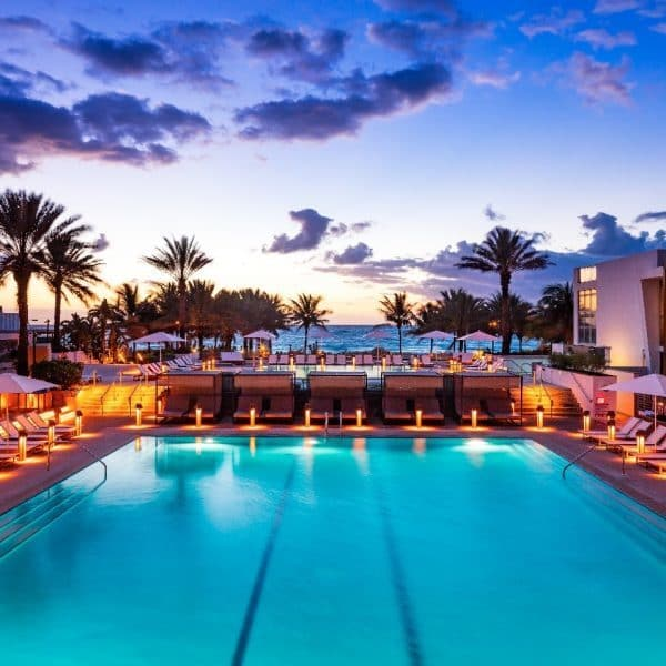 View of the swimming pool in the evening at Eden Roc Miami Beach Resort in Florida