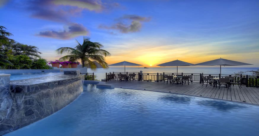 View of the split level swimming pools at sunrise at Cap Maison in St Lucia