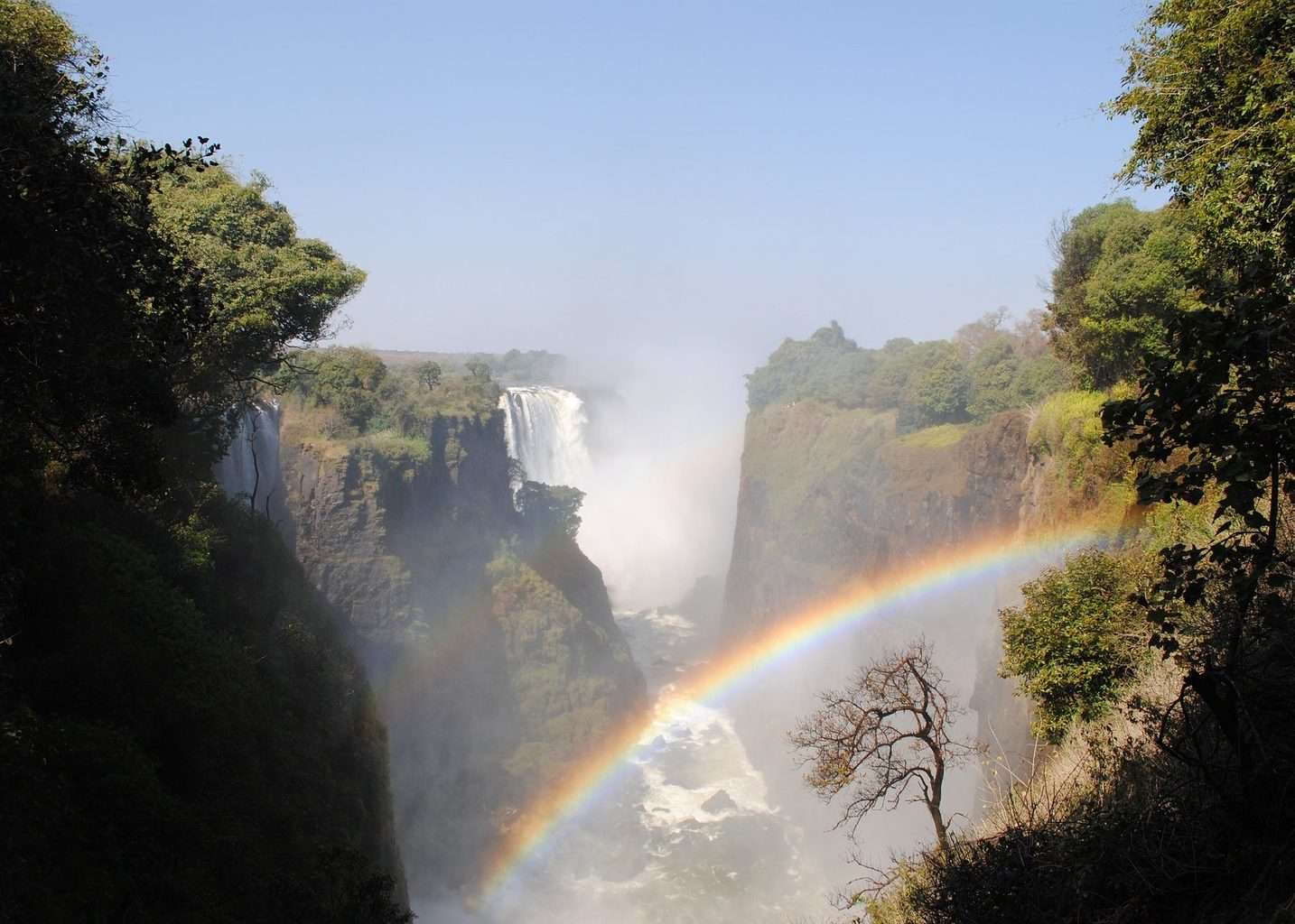 View of Victoria Falls Zambezi with rainbow in spray, part of the Kruger and Victoria Falls tour