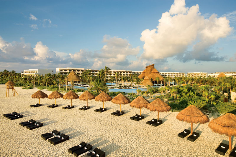 View of the beach and sun loungers at Secrets Maroma Beach in Riviera Cancun, Mexico