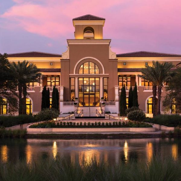 View of the exterior at dusk of Four Seasons Orlando Resort
