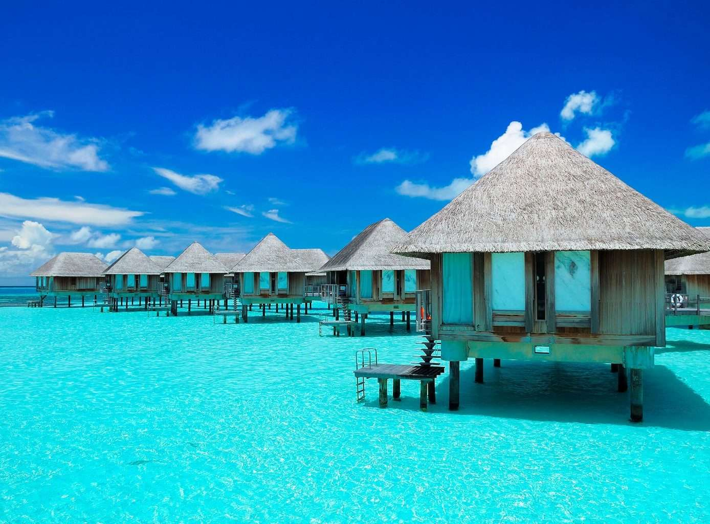 Asia Luxury Holidays and Indiann Ocean Calm, Overwater bungalow blue sea and sky view