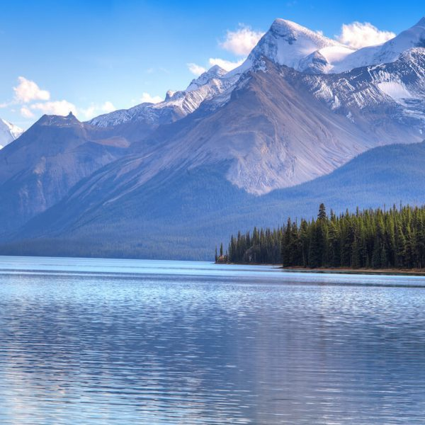 Luxury Canada Holidays - Beautiful mountain, spruce trees and lake shot