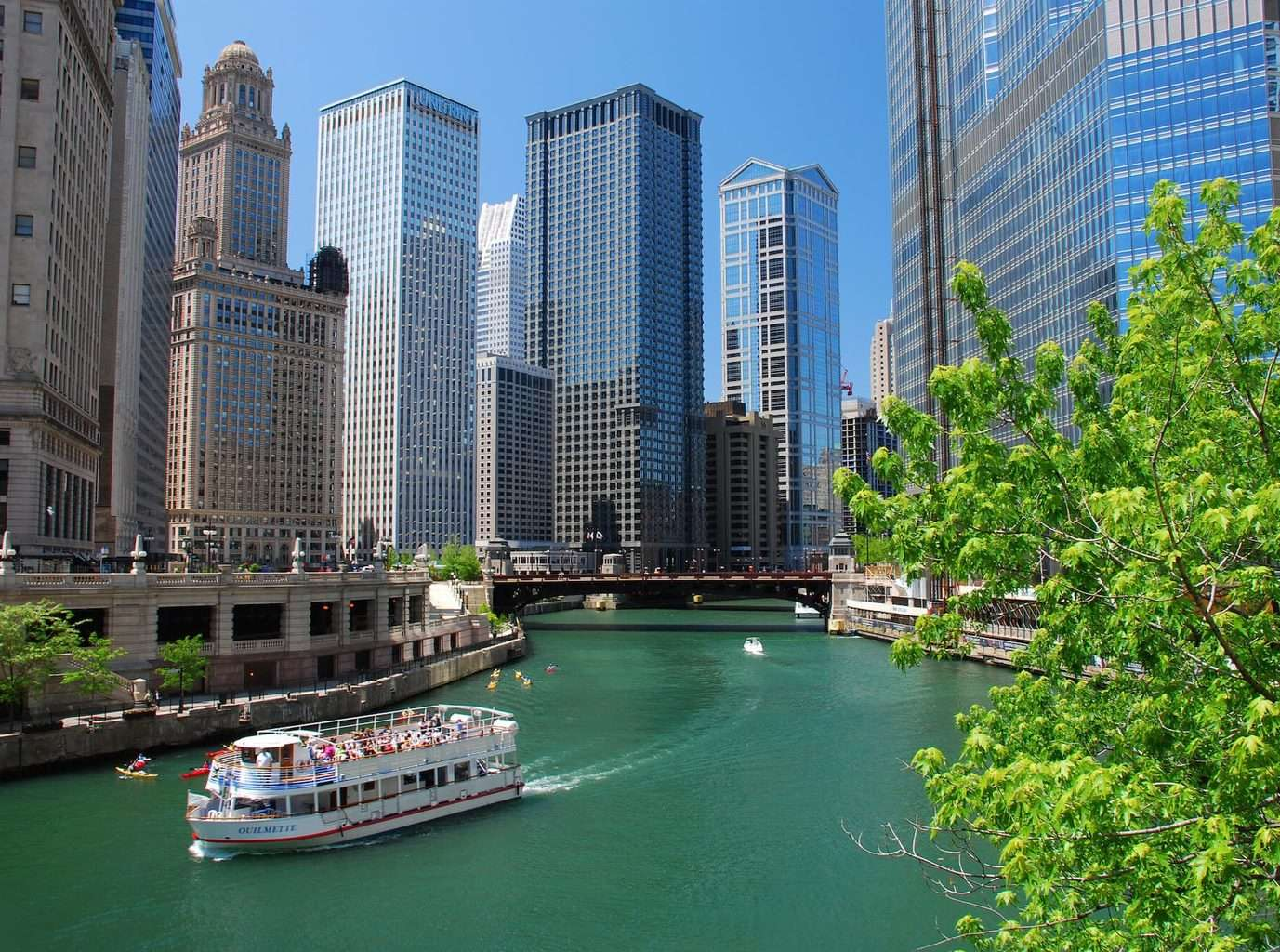 Luxury Trip to Chicago - River encased with glass buildings and skyscrapers