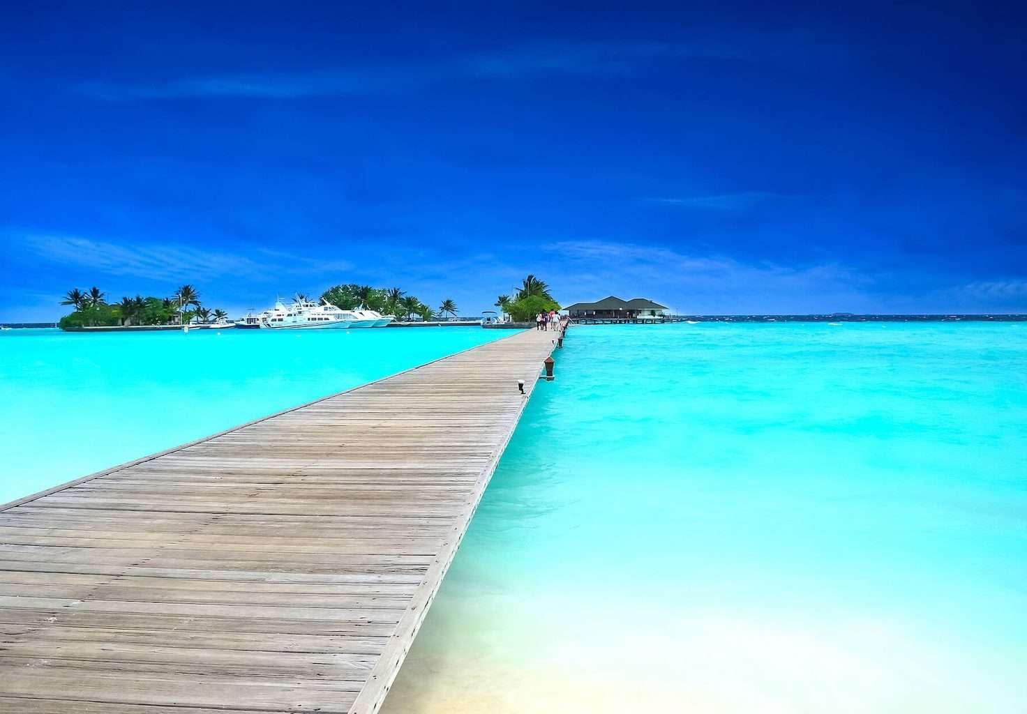 Clear sea and jetty at Six Senses Laamu in Maldives