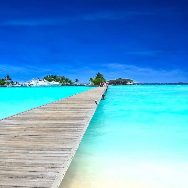 Clear sea and jetty at Six Senses Laamu in Maldives
