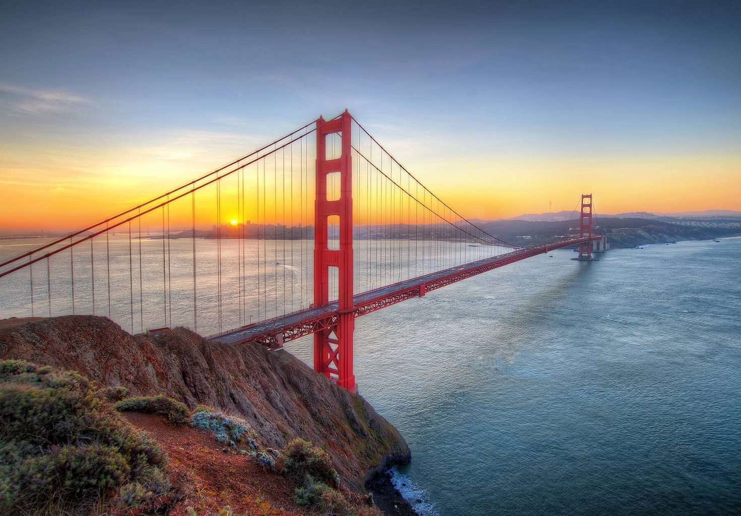 Luxury San Francisco Holiday - Golden Red Gate Bridge at sunrise over water