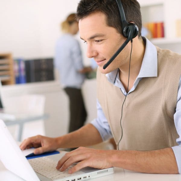 Luxury Travel Agent on phont with headset on