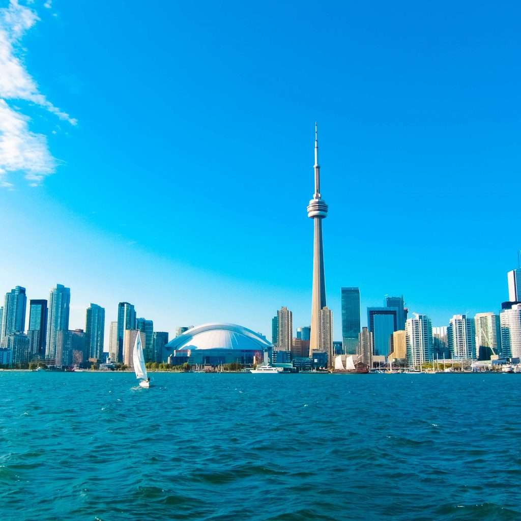 Luxury Holidays to Toronto - City view and ocean with toronto tower