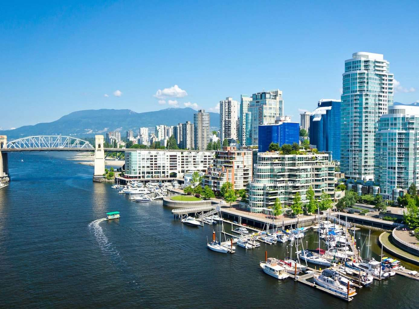 Luxury Vancouver Holidays - Lions Gate bridge, citry and ocean view