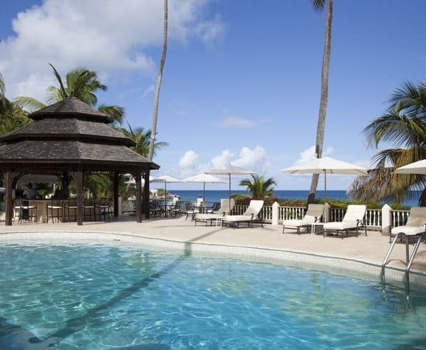 View of the swimming pool at Blue Waters Hotel in Antigua