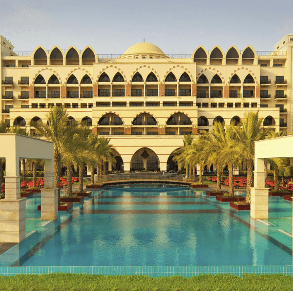 View of the resort across the swimming pool at Jumeirah Zabeel Saray, Dubai in UAE