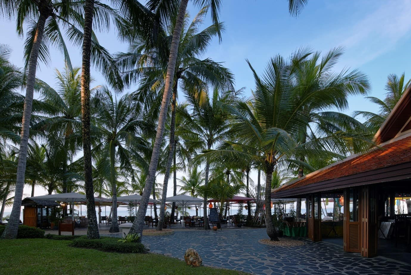View of the beach with palm tree at Santiburi Beach Resort & Spa Koh Samui in Thailand