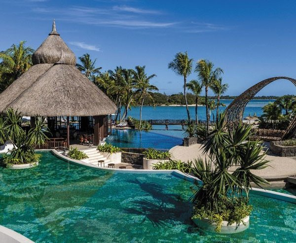 View of the swimming pool and beach at Shangri-La Le Touessrok Resort in Mauritius