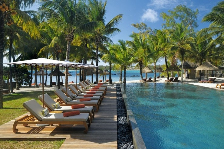 View of the swimming pool and sun loungers at Constance Le Prince Maurice in Mauritius