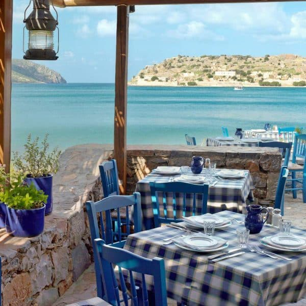 Dine and overlook the Mediterranean at Blue Palace, A Luxury Collection Resort, Crete.