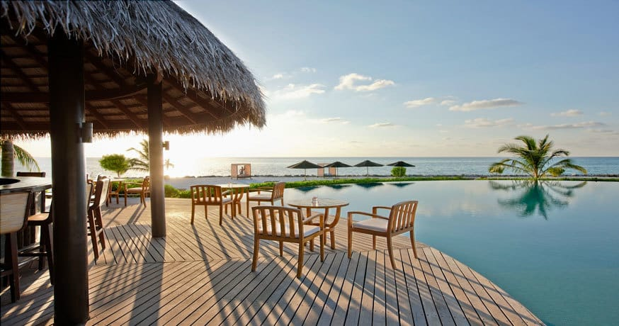 LUX South Ari Atoll, sunset view across the bar, pool, beach and Indian Ocean