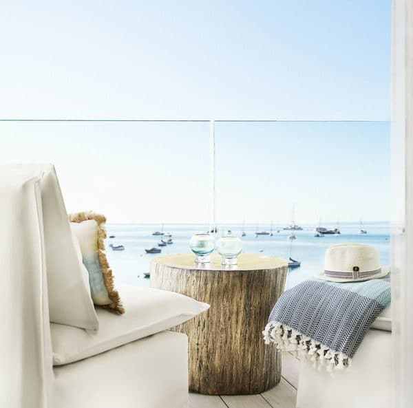 Close up view of the terrace seating, clean and contemporary, overlooking the sea at Nobu Hotel Ibiza Bay