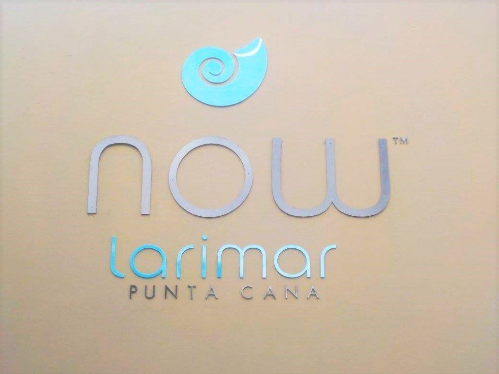 View of the Now Larimar Punta Cana logo on the outside of the hotel