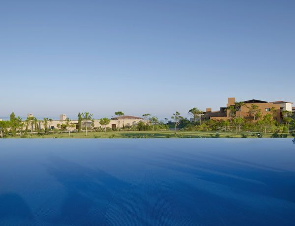 View across the pool at The Romanos, A Luxury Collection Resort in Costa Navarino, Greece