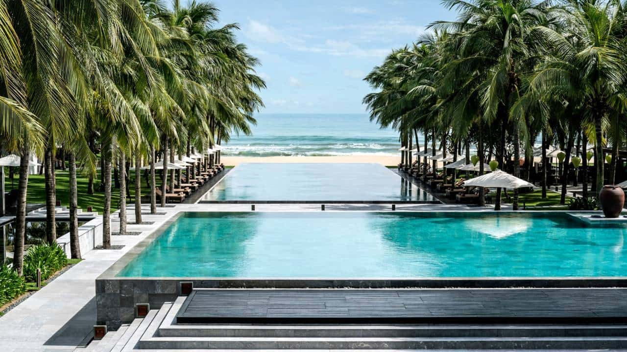 View of the swimming pool at Four Seasons The Nam Hai in Hoi An, Vietnam