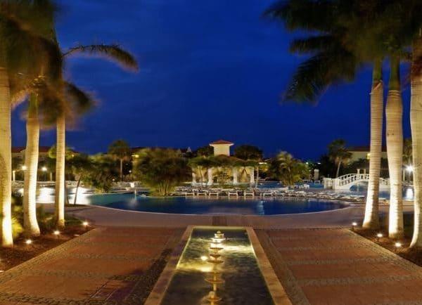 Night view of the swimming pool and palm trees at Paradisus Princesa del Mar in Varadero, Cuba