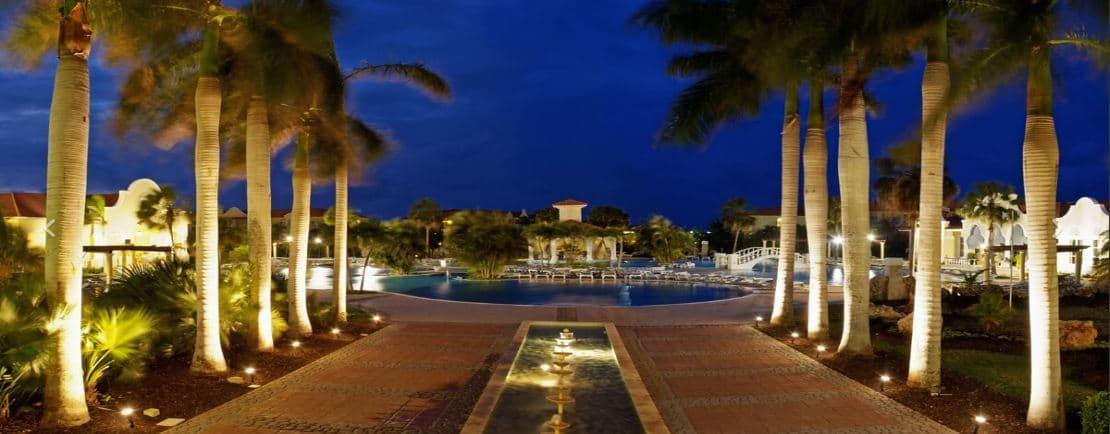 Night view of the swimming pool and palm trees at Paradisus Princesa del Mar in Varadero, Cuba