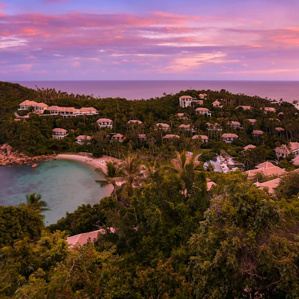 View of the property exterior and the villas during the sunset at Banyan Tree Samui in Thailand
