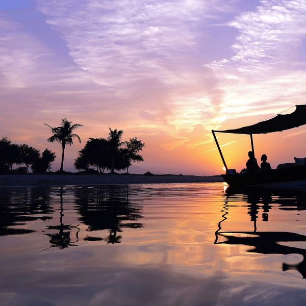 View of the abra cruise at sunset from Ritz-Carlton Ras Al Khaimah in United Arab Emirates