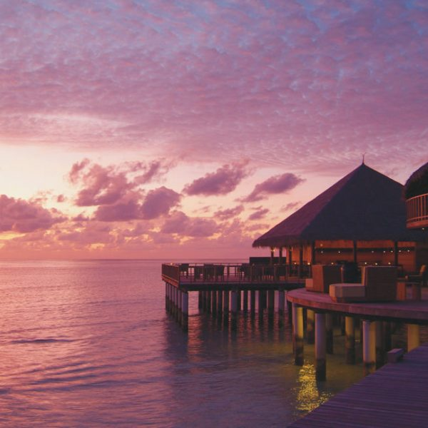 A pink and purple sunset at Coco Bodu Hithi in Maldives