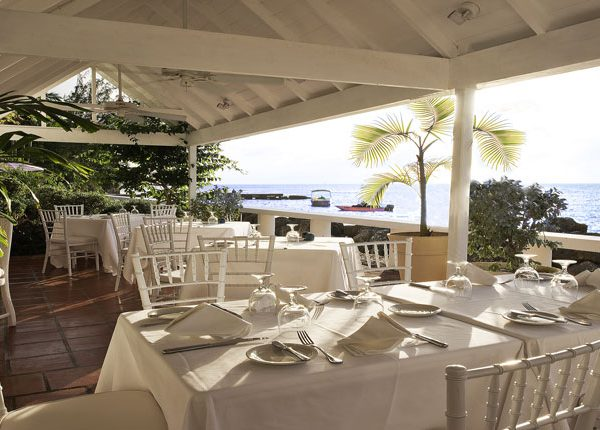 View of the dining area overlooking the beach at Cobblers Cove in Barbados