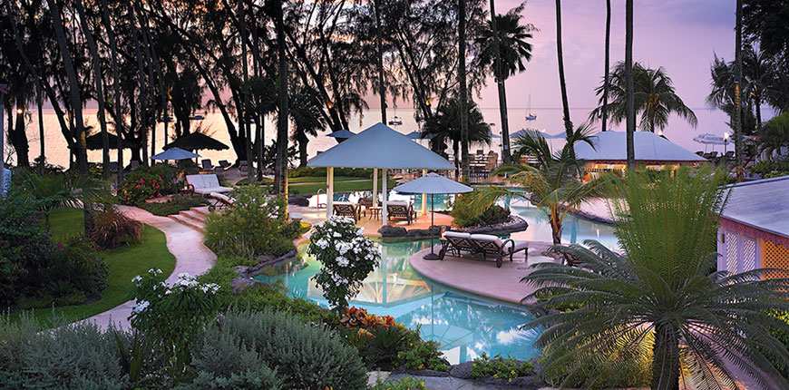 View of the swimming pool at Colony Club by Elegant Hotels in St James, Barbados
