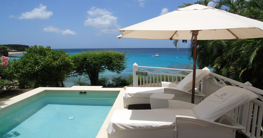 View of the private swimming pool at The Cotton House in Mustique