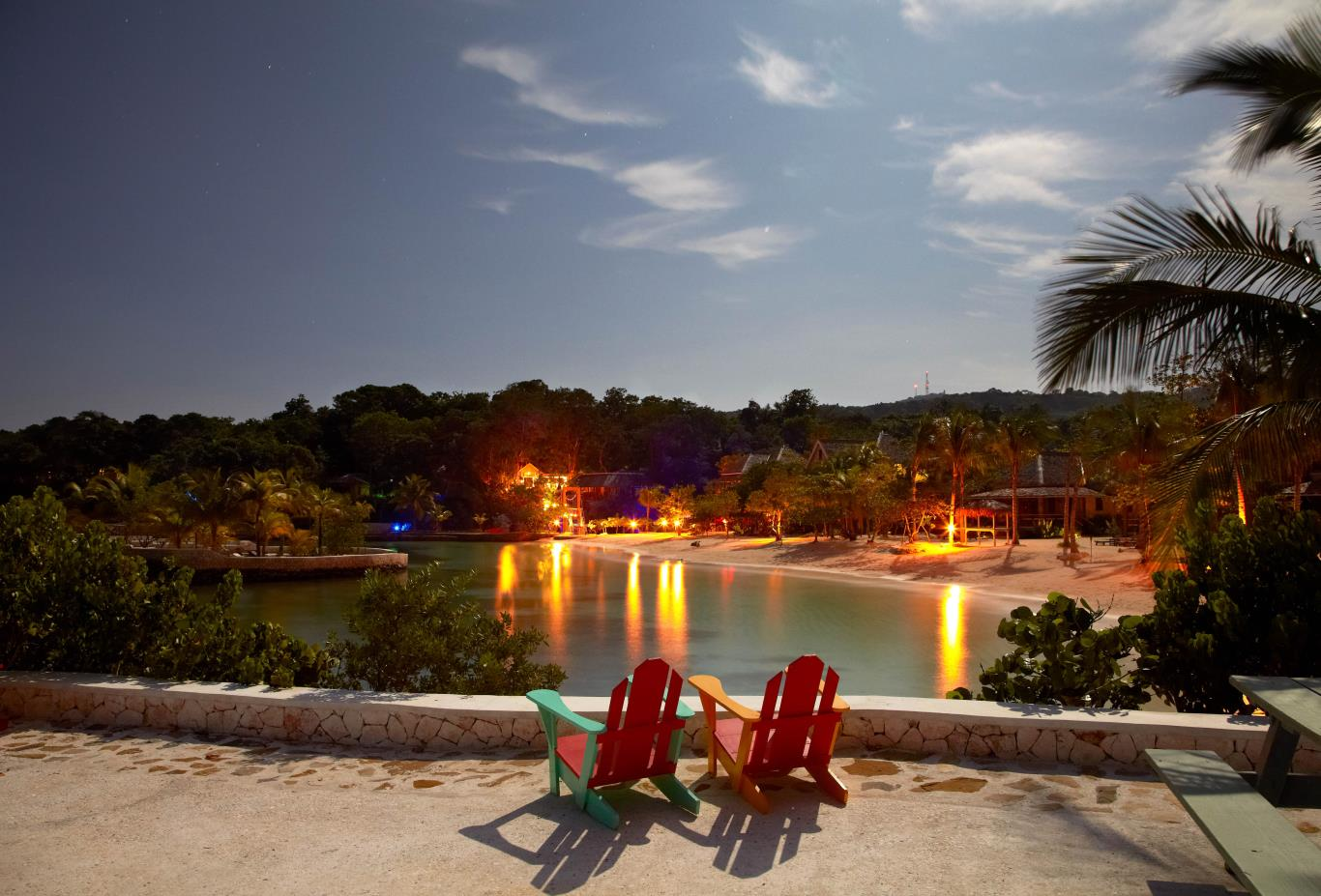 View of the beach and lights in the evening at GoldenEye Boutique Resort in Jamaica.