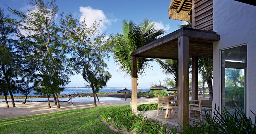 View of the beach and exterior at Long Beach Resort Golf & Spa in Mauritius.