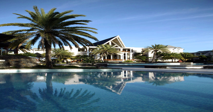 View across the swimming pool to the main building at The Residence Mauritius