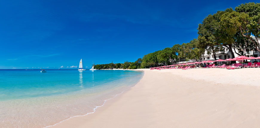 View of the beach and sun loungers at Sandy Lane in Barbados