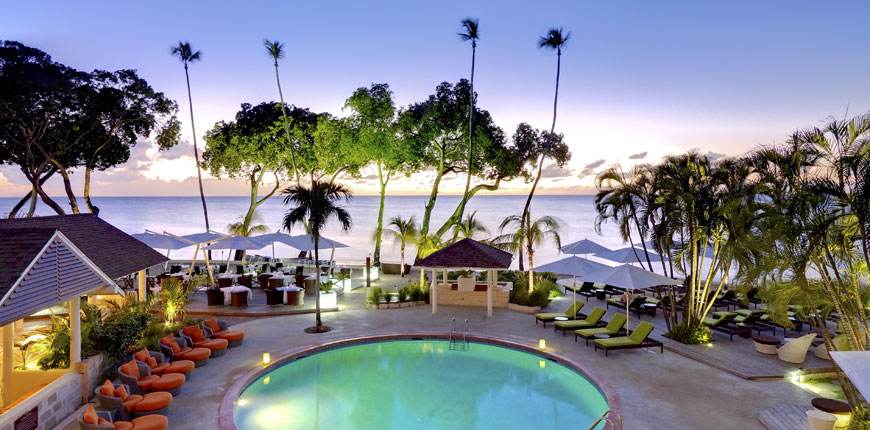 View of the swimming pool and the beach at Tamarind by Elegant Resorts in Barbados