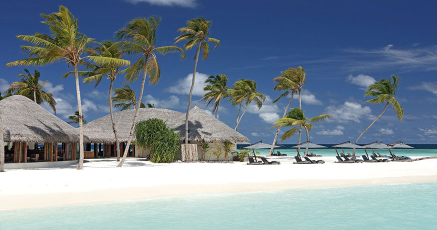 View of the beach and accommodation at Constance Halaveli in Maldives