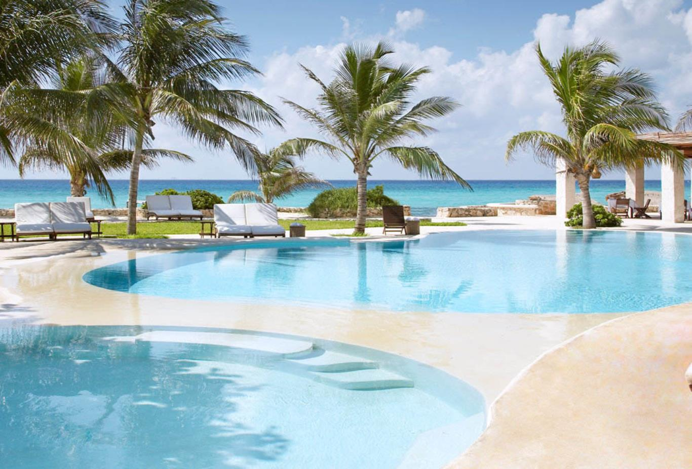 View of the swimming pools at Viceroy Riviera Maya in Cancun, Mexico
