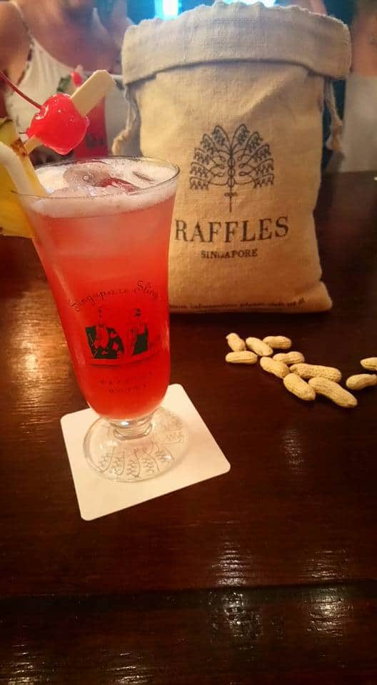 A Singapore Sling with peanuts in the Billiards Room at Raffles Singapore. Things to do in Singapore blog post.