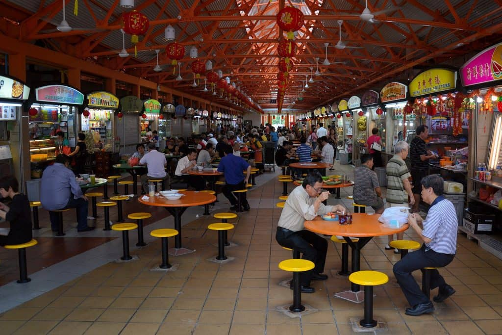 A view inside one of the hawker centres in Singapore where you can enjoy the local street food. Things to do in Singapore.