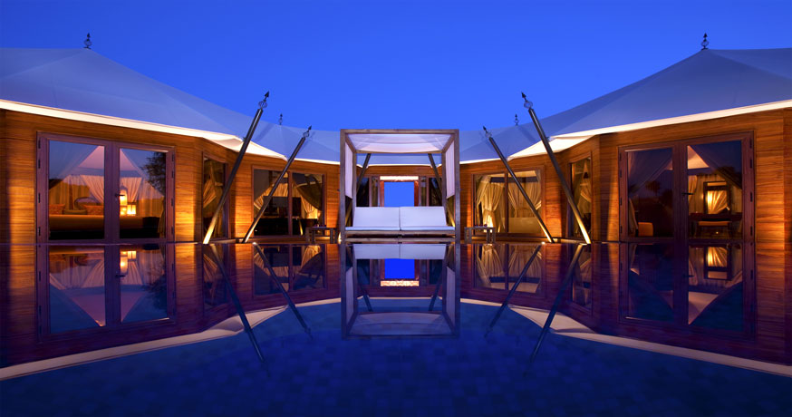 Exterior view at night of the Ritz-Carlton Ras Al Khaimah, Al Wadi Desert, UAE