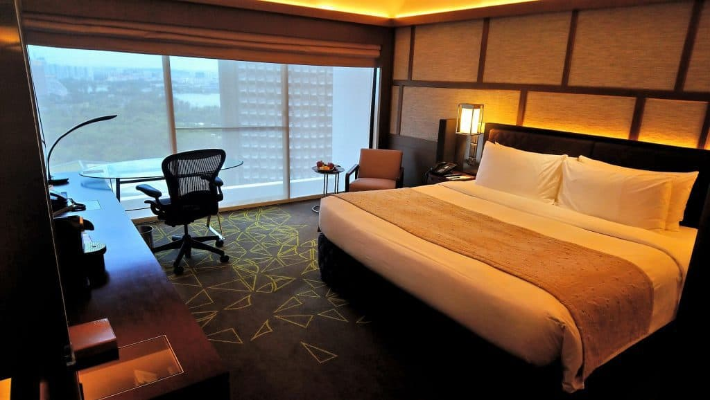 View of the bedroom in a Panoramic Room at the Pan Pacific Singapore