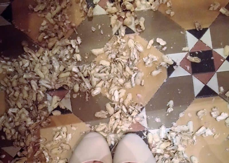 Peanut shells on the floor at Raffles Singapore Hotel