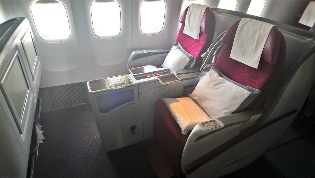 View of the aisle and window seats in Qatar Airways Business Class onboard the A330